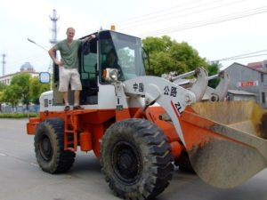 Rich and Adam, getting trips around the city by tractor. This kind of random thing happens in China.