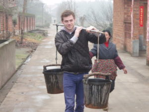 A friend Tom from UK who travelled in rural China to working at a local form