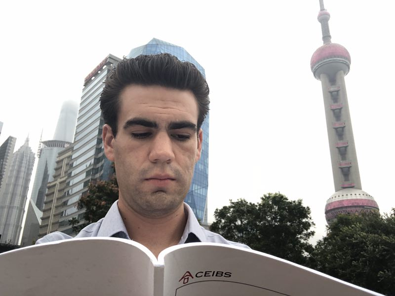 A CEIBS Student reading the school handbook